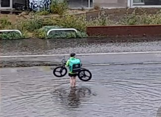 Uber Eats cyclist in puddle - Scottish News