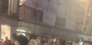 Crowd singing into camera - Scottish News