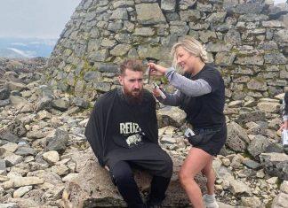 Owner Terri cutting hair on top of Ben Nevis | Scottish Nevis