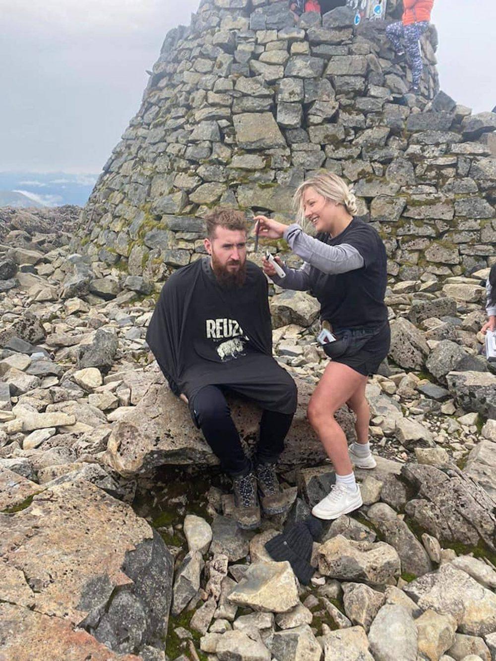 Owner Terri cutting hair on top of Ben Nevis   Scottish Nevis