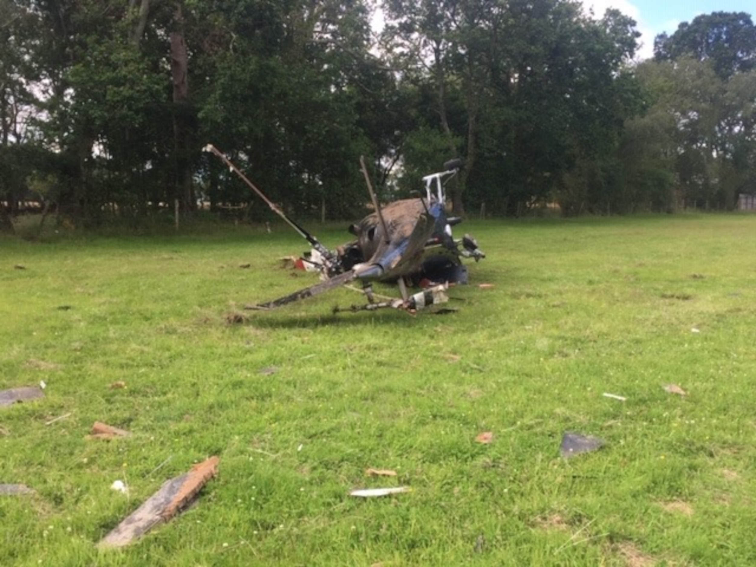 crashed helicopter from side dorset - fire and rescue news UK