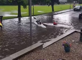 Jardine and Max kayaking in the flooding   Scottish Weather News