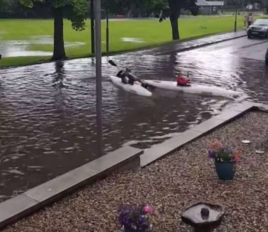 Jardine and Max kayaking in the flooding | Scottish Weather News