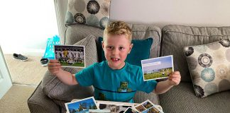 Little Ethan McCann with his postcards - UK News