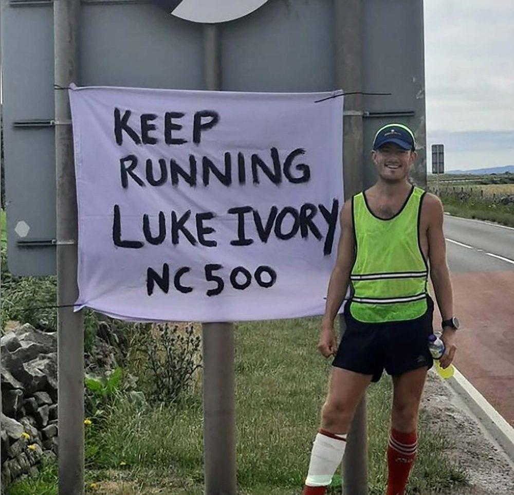Luke Ivory next to his support sign | Scottish News