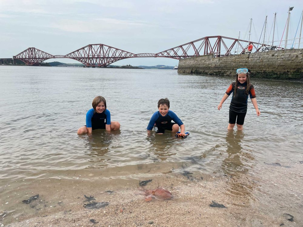 The kids pictured with the octopus at Queensferry - Scottish Wildlife News