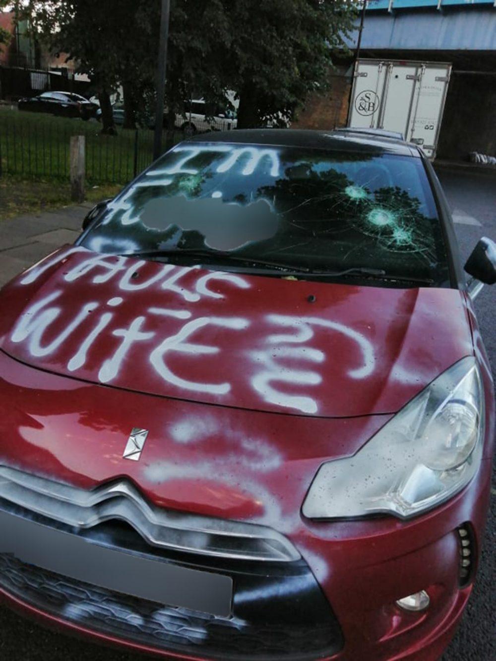 The red Citroen covered in white graffiti -London Crime News