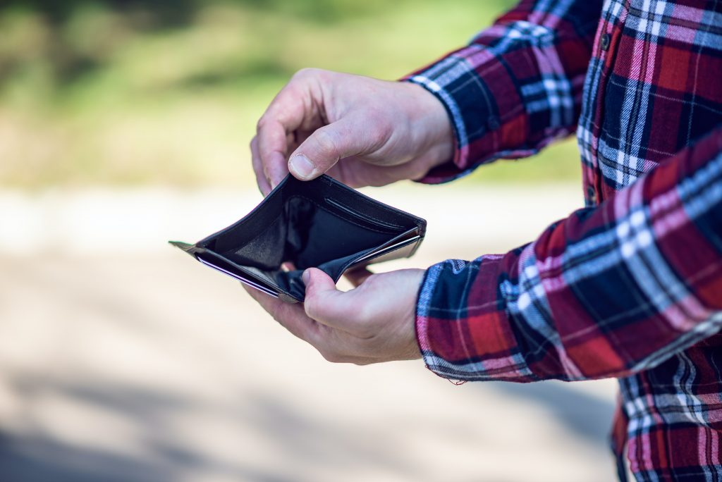 person opening empty wallet - Scottish News