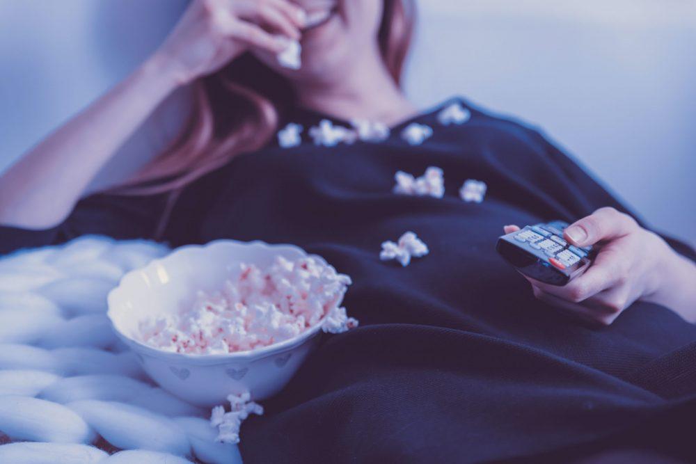 woman eating popcorn - scottish news