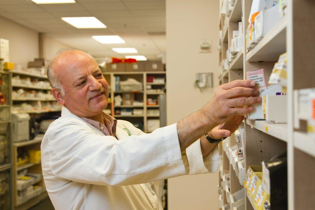 man working at pharmacy - Scottish News