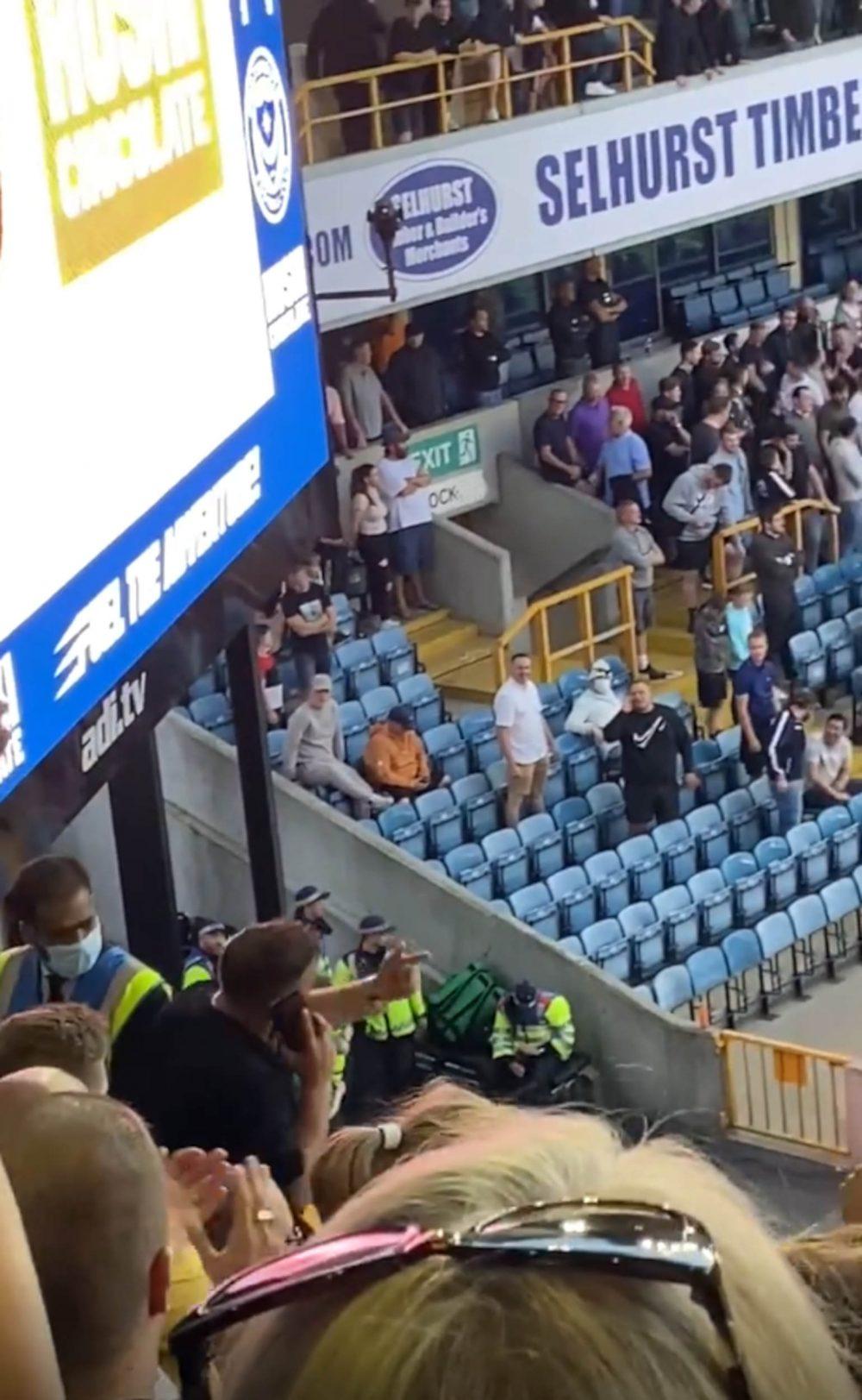Footie fans on phone - Football News UK