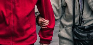 Two adults linking arms - Health News Scotland