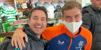 Martin Compston poses with Rangers fan outside Glasgow Airport Celtic Shop