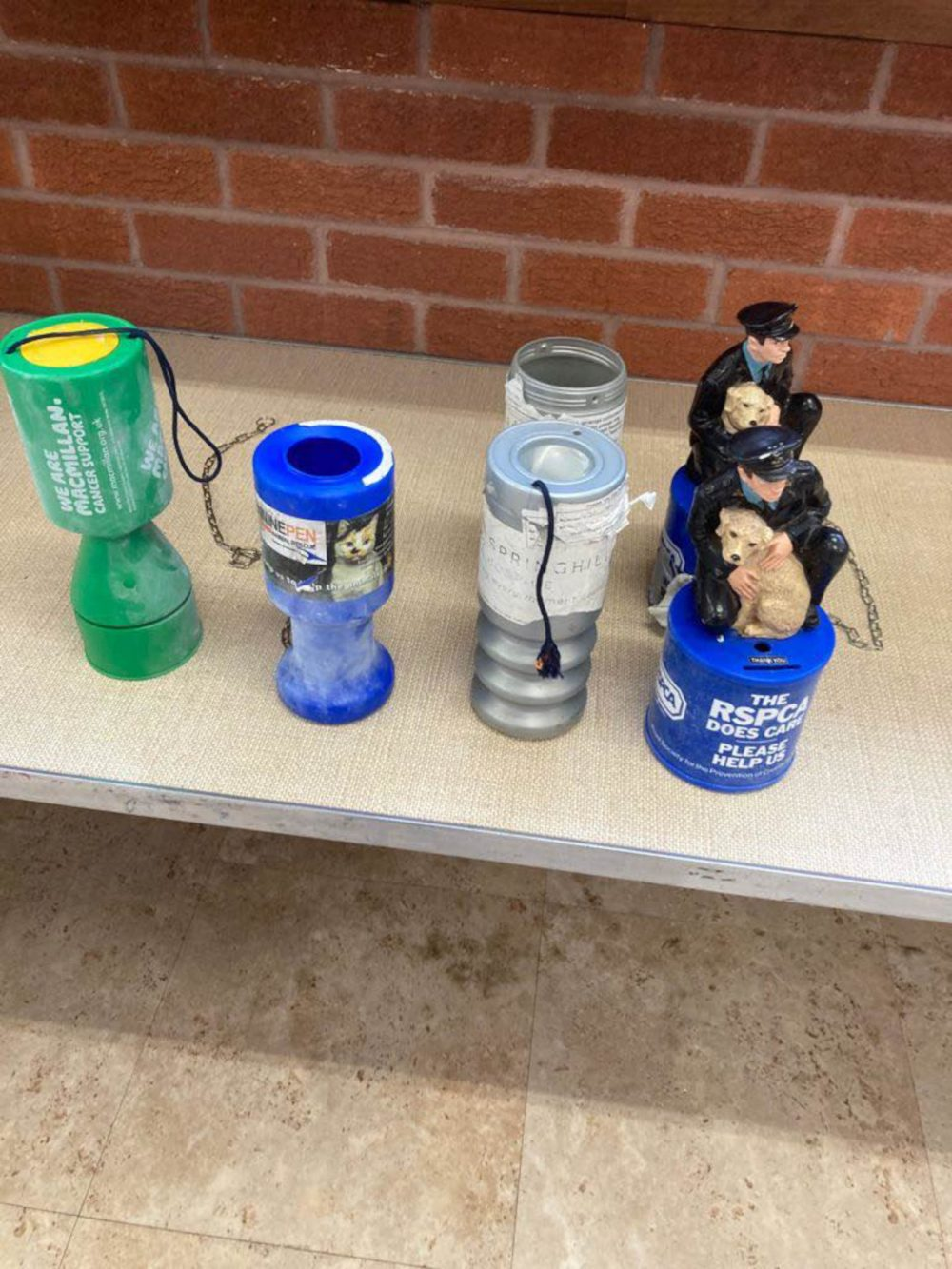 The collection tins were stolen during the break in - Crime News UK