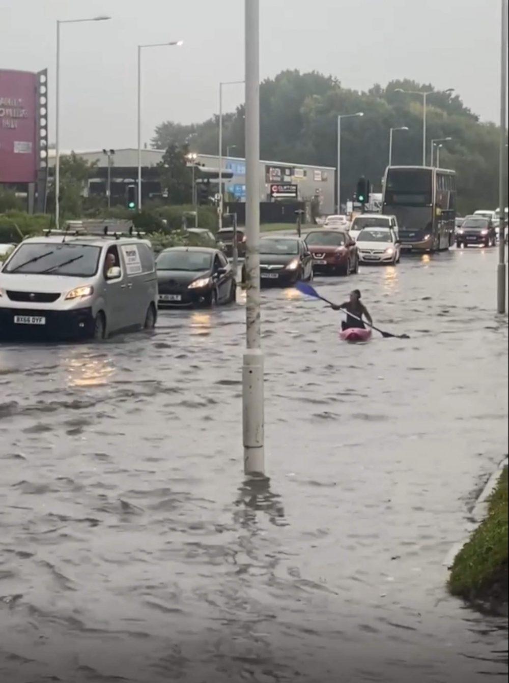 Kayaker in traffic - weather news UK