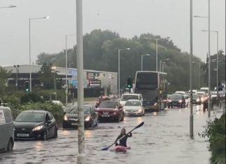Kayaker doing laps of street - weather news UK