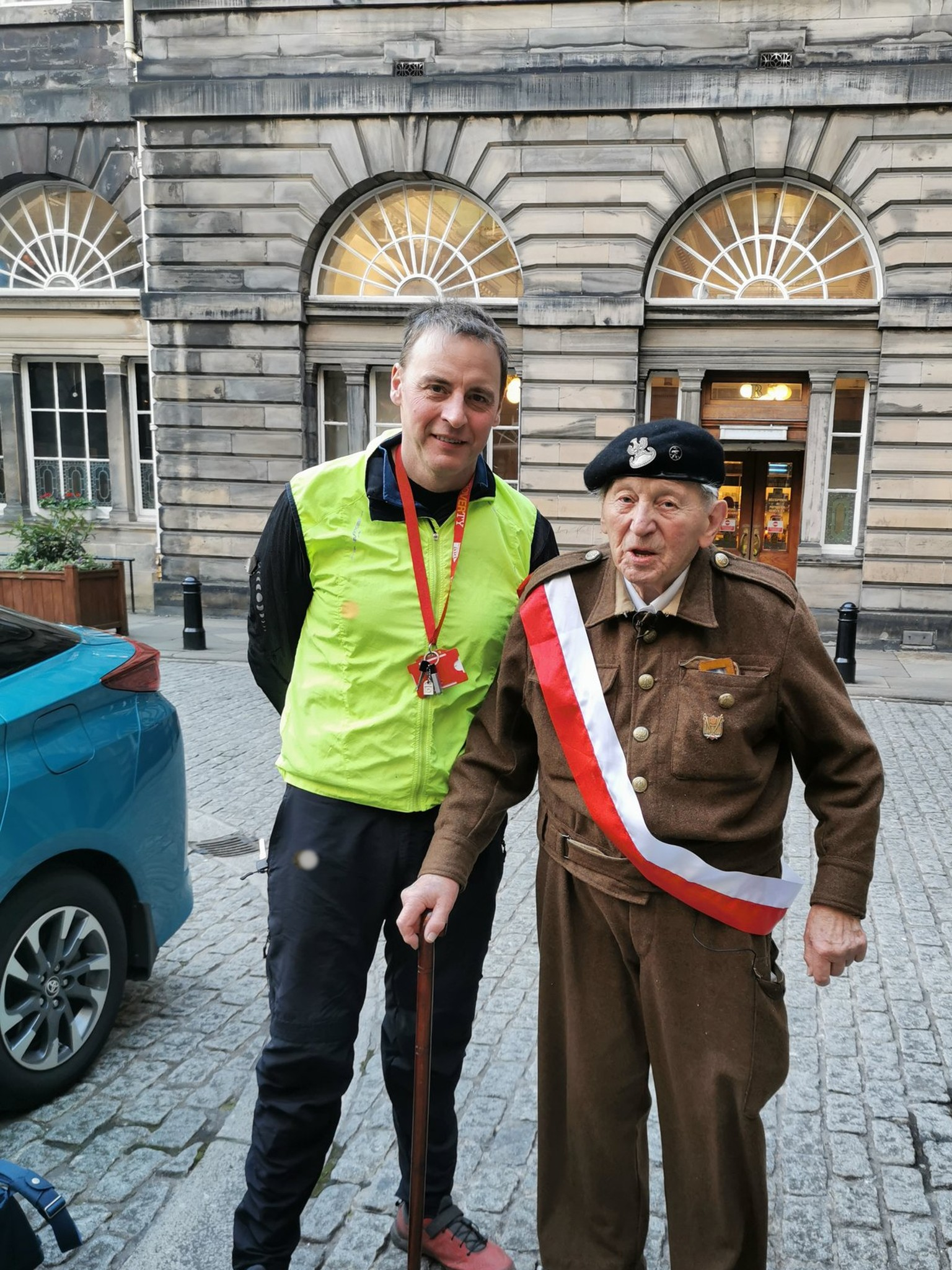 Ludwik Jaszczur wearing old military outfit takes photo with Cllr Scott Arthur