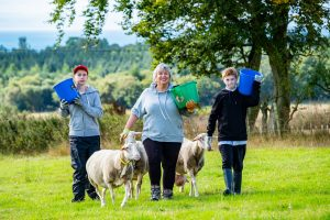 Libby Elliot with interns William Wishart and school pupil Josh Anderson - Lucky Ewe