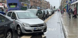 Car parked across cycle lane - Transport News