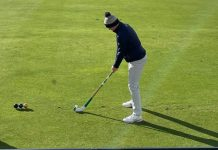 Robert MacIntyre tees off with a shinty stick