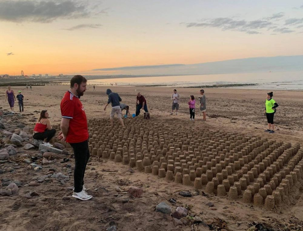 Wray Thomson looking at tribute sandcastles | Scottish Health News