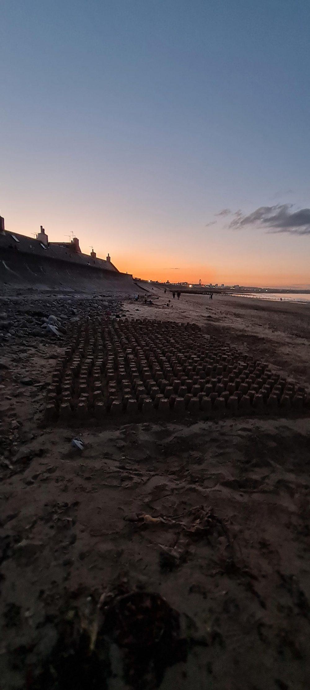 Sun setting over sandcastle tribute | Scottish Health News
