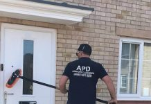 Adrian at work in his window cleaning business - UK News