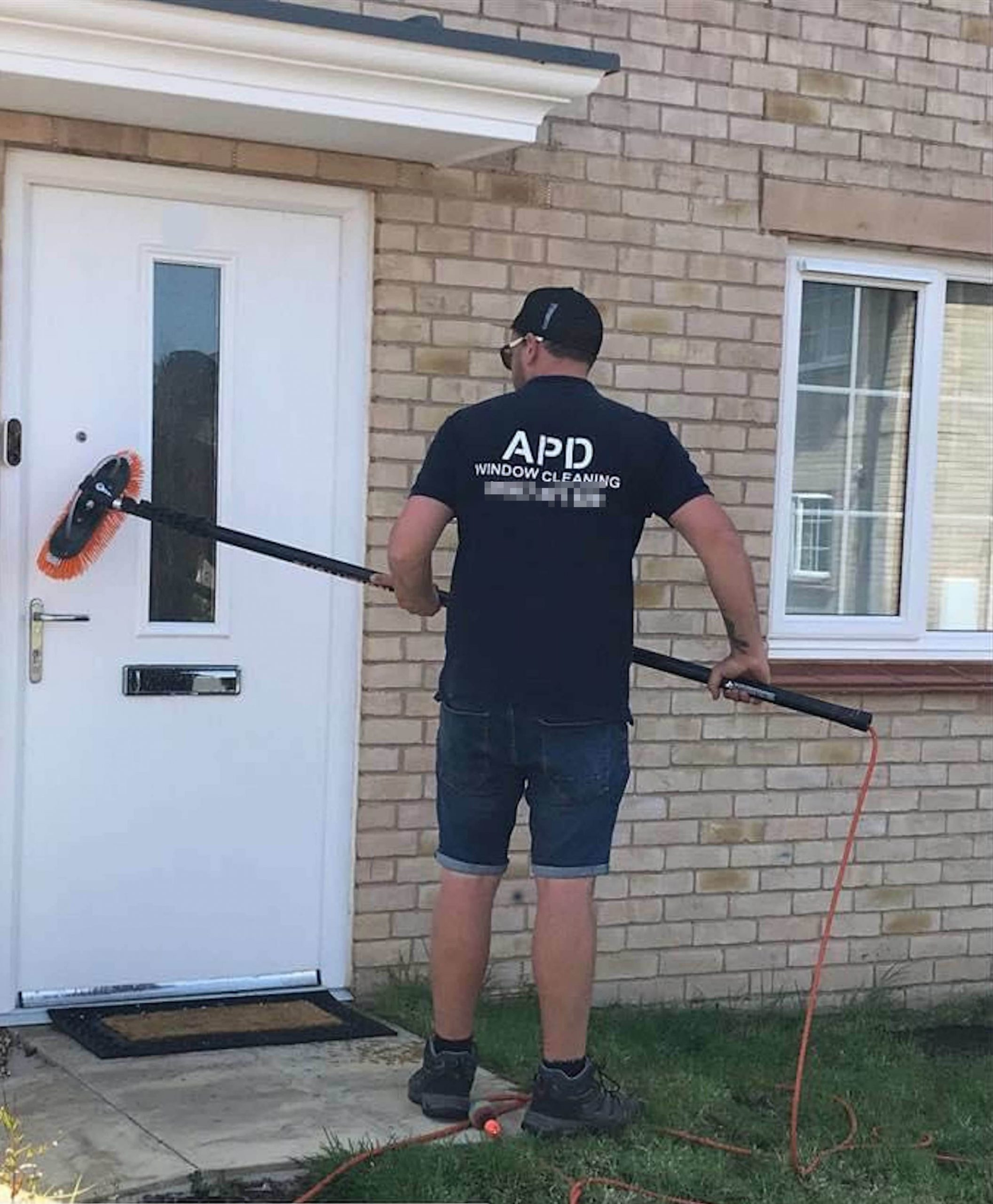 Adrian at work in his window cleaning business- UK News