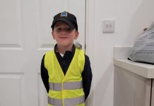 Oliver posed for the camera, dressed as his Aldi HGV driver dad James.