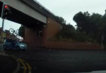 The cyclist crashing into the car and being catapulted over the bonnet.