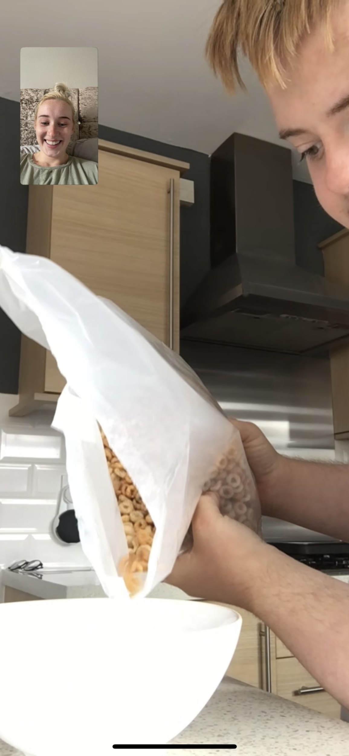 Michael McEwan carefully making his sister's cereal
