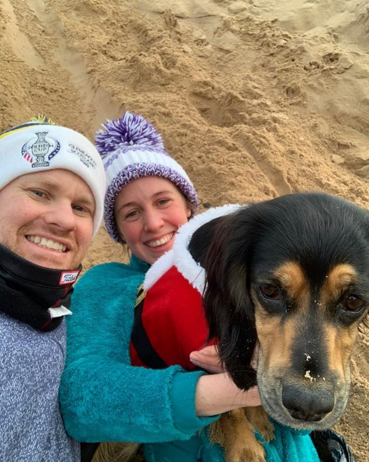 Hannah with her partner Euan and their dog Poppy.