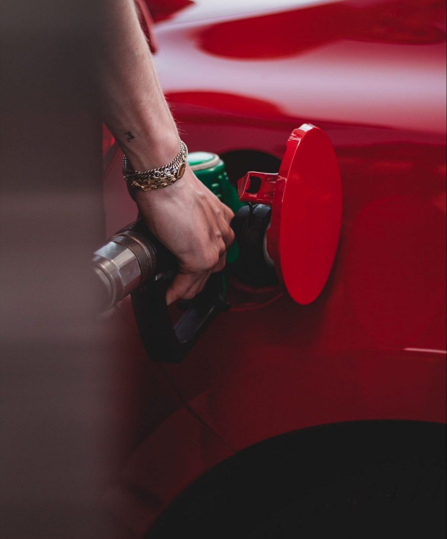 Filling fuel tank at petrol station